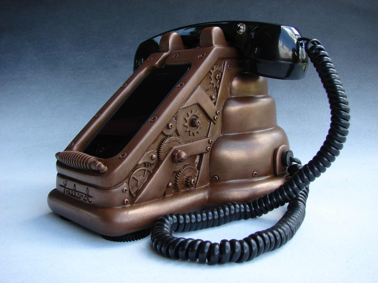 A steampunk iPhone dock that makes the Bat Phone look lame